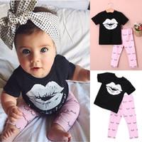 pantalon corto para niña rosa al por mayor-Niñas bebés camisetas cortas negro blanco labio tops ojos de los niños pantalones largos grometric trajes encantadora estilo rosa venta caliente real de fábrica
