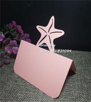 diseño de tarjeta de presentación al por mayor-50 unids / lote corte láser Seaside Style Star Design Invitación de boda Tarjetas de soporte de mesa Nombre Lugar Asiento Tarjetas de papel Decoración de la fiesta