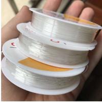 ingrosso corda del braccialetto del rotolo-1 rotolo trasparente elastico elastico corda cordoncino perline perline fai da te per monili che fanno BraceletNecklace 0.5-1.0MM