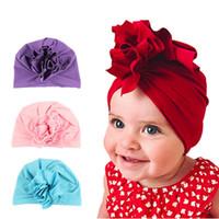 neugeborenes mädchen hüte blumen großhandel-Neue Mode Blume Baby Mützen 2018 Neugeborenen Elastische Baby Turban Hüte für Mädchen 10 Farben Baumwolle Infant Beanie Cap