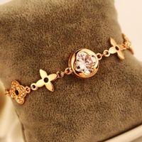 ingrosso braccialetto del braccialetto del trifoglio del fiore-Moda placcato oro catena Clover Bracciale Bangles per le donne Vintage Hollow Out Fiore Zircone Charms Bracciale marca gioielli partito Costume
