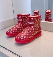 botas de invierno de las señoras más cálidas al por mayor-Mujeres de la marca de invierno Botas de nieve Diseñador Dama de impresión de cuero botín botín Fashion Girl Botas de suela de goma de goma caliente