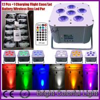 dmx 512 remoto al por mayor-12 luces + estuche de carga RGBWA + UV Led alimentado por batería inalámbrico dmx led par uplighting con control remoto infrarrojo 6 * 18W