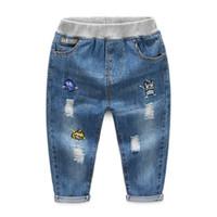 caricature de pantalon cargo achat en gros de-Garçons Automne Pantalon Denim Enfants Jeans pour Enfants Cartoon Coton Jeans Taille Élastique Jeans Garçons Pantalons Casual Trou Trou Jeans