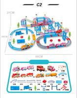 pistas de plástico del coche al por mayor-C2 Nuevos juguetes ferroviarios de qumitoys train track coche eléctrico Bebé juguetes educativos de plástico juguetes de inteligencia