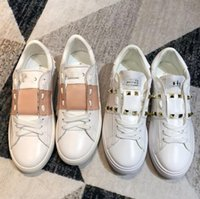 Wholesale concrete modelling resale online - New fashion rivet small white shoes women s wild leather flat casual shoes color matching couple models design white shoes