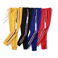 pantolon toptan satış-Erkek Lüks Jogging Yapan Pantolon Yeni Markalı İpli Spor Pantolon Yüksek Moda 4 Renkler Yan Şerit Tasarımcı Joggers