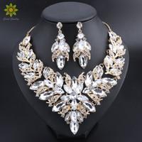 asiatischen indischen goldschmuck großhandel-Luxus-Blumen-indische Brautschmucksachen stellen Hochzeits-Kostüm-Gold überzogene Halsketten-Ohrringe ein, die gesetzten Kristallsatz-Schmuck für Braut-Frauen eingestellt werden