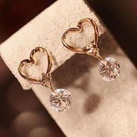 Wholesale Wholesale Party Supplies Direct - white rose gold plated anti-allergic zirconium zircon earrings Korean version of the jewelry factory direct supply wholesale