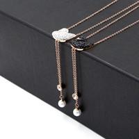 ingrosso ciondolo perla di cigno-Collana con ciondolo in cigno nero e bianco con pendente in oro rosa placcato in titanio per gioielli con collana con frange di perle da donna
