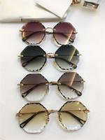ingrosso lenti chiare-New fashion popolare designer donna occhiali da sole poligono frameless con taglio lensframe chiaro lente colorata occhiali ultra-light 142