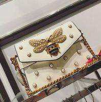 Wholesale White Pearl Clutch Bag - Factory brand handbag lovely Rhinestone chain bag elegant woman bee pearl decorative leather shoulder bag women bag small fresh pearl sprin
