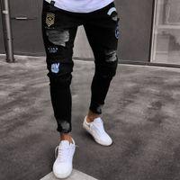 hochwertiges gold verkauft großhandel-Heiße Verkaufs-Mann-Entwerfer-Jeans-schwarze Jeans-Mann-beiläufige männliche Jean-dünne Motorrad-Qualitäts-Denim-Hosen