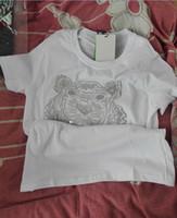 женские тигровые пуловеры оптовых-Вышитые Tiger Head футболки трикотажные изделия из чистого хлопка o-образным вырезом пуловер с коротким рукавом рубашки горячий бренд тройники мужчина и женщина