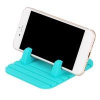 universal-silikon-gps-halter großhandel-Weiches Silikon-Handy-Halter-Auto-Armaturenbrett GPS-Antibeleg-Mat-Desktop-Standplatz-Klammer für iPhone x 8 5s 6 7 Samsung s9 Tablette