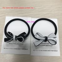 ingrosso legame di bowknot-4 pezzi di design di lusso bowknot forma cravatta per capelli accessori oggetto di raccolta acrilico corda dei capelli incidere marchio di moda regalo del partito di vip con parper card