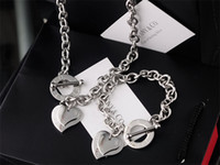 Wholesale green crystal shaped plastic for sale - Group buy Hot High Quality Celebrity design Letter Silver bracelet necklace Silverware Fashion Metal Heart shaped Gold Jewelery Set pc With Box