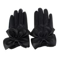 ingrosso guanti in pelle nera per le donne-Brand new 2015 Fashion Mittens Women Ladies Inverno Butterfly Bow polso nero in morbida pelle Guanti