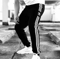 ingrosso pantaloni da corsa liberi-AD nuovo street wear S-2XL uomini jogging moda a strisce lettera stampa uomini pantaloni da corsa nuova marea sport jogging per gli uomini spedizione gratuita