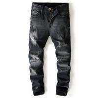 marcas famosas designer jeans venda por atacado-Jeans Rasgado Preto Dos Homens Com Buracos Casuais Famoso Designer Da Marca Slim Fit Jeans Destruído Calças Jeans Reta Rasgado Fino Zíper