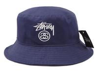 pesca de golf al por mayor-Diseñador de moda de cuero sombrero del cubo para hombre para mujer gorras de pesca plegables pescador de playa de pescador negro venta hombre plegable gorra de bombín