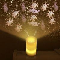 neuheit weihnachtsbaum lichter großhandel-Neuer Weihnachtsprojektor beleuchtet die flammenlosen Baum-Schneeflocke-Kerzen mit Fernsteuerungsneuheit Dreh-LED-Nachtlicht für Kinderweihnachtsparty