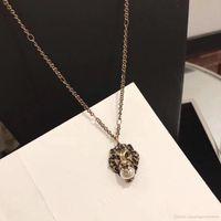 ingrosso fascini d'ottone natale-La collana d'ottone lussuosa d'ottone del pendente della testa del leone con la perla della natura decora e timbrica il gioiello di giorno di natale dei gioielli della collana di fascino del bollo