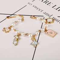 Wholesale flowers alice - MQCHUN fashion women jewelry accessories cute alice in wonderland rabbit clock imitation pearl link chain bracelet charm bangle