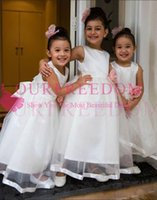 Wholesale girls beach cover - 2018 White Cute A Line Flower Girls Dresses Back Cover Bow Tulle Elegant Floor Length First Communion Dresses For Garden Beach Wedding