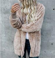 vêtements en fourrure pour femmes achat en gros de-Femmes Faux Vestes d'hiver de fourrure Manteaux Manteaux à capuchon de velours de poche design Manteaux Loose Women Vêtements Hauts chaud Vêtements de doux