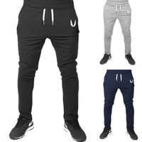 Wholesale trousers wing - Trousers men's muscle flying V sub wing sports fitness running cotton pants free shipping good quality Asia size so choose bigger size