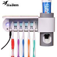 pasta de dientes para montaje en pared al por mayor-3-en-1 Pasta de dientes titular dispensador de cepillo de dientes y cepillo de dientes esterilizador del desinfectante Conjunto de montaje en pared Soporte Herramienta Familia