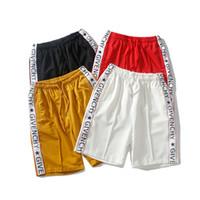 Nuovo modello Tide Brand Beach Jogger pantaloni corti moda stile di estate  lettera stampa pantaloni justin bieber uomini hip-hop pantaloncini larghi 589e1293759f