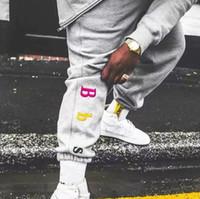 kalça şapkalı pantolon toptan satış-Gökkuşağı Harf Pantolon Erkekler Ve Kadınlar Splice Pamuk Nakış Pant Ins Moda Hip Hop Pantolon HFBYKZ008