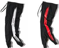 ingrosso pantaloni di harem arancioni neri-Pantaloni Jogging in Pareggiatore Pantaloni Harem Cool Pantaloni sportivi neri Pantaloni Jogger a righe arancioni Kanye West Calabasas Streetwear sup Tute da uomo