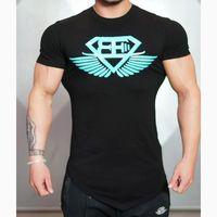 Wholesale unique sweatshirts - solid color unique shape undershirt men's sweatshirts thin slim fitness bodybuilding short sleeve muscle men t-shirt