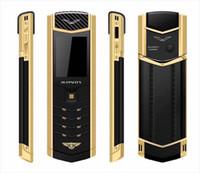 teléfonos celulares de marca bluetooth al por mayor-Marca original MPARTY LT2 Cuerpo de metal dorado de lujo Carcasa de cuero Teléfono móvil Teléfonos móviles Dual Sim Bluetooth FM Cámara Mp3 teléfono móvil