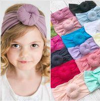 bandas para la cabeza del bebé de nylon al por mayor-Baby Kids Turbante cintas elásticas de Nylon Soft Flower ball calcetines de nylon material BAby bandas para el cabello cabeza de las niñas envuelve los niños de invierno sombreros
