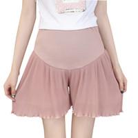 más el tamaño de pantalones cortos de cintura alta al por mayor-Las mujeres embarazadas de maternidad plisaron los pantalones de la falda de la gasa Pantalones cortos del verano más el tamaño cintura alta pantalones anchos sueltos de la pierna ancha para la parte inferior del embarazo