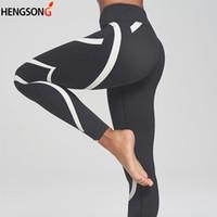 leggings de entrenamiento negros al por mayor-Leggings de rayas blancas negras Mujeres Push Up Fitness Leggings Gimnasio elástico transpirable Entrenamiento Ropa deportiva para mujeres 2018 Nuevo