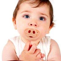 ücretsiz bebek emzikleri toptan satış-Perakende 1 ADET Yeni Komik Silikon Bebek Emzikler Yenidoğan Çocuklar Ortodonti Diş Emzik Bebek Diş Kaşıyıcı Nipeller Domuz Burun ÜCRETSIZ KARGO