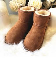 mode schnee stiefel frauen leder großhandel-Klassischer Winter halten warme kurze Mini 58541 Schneestiefel Marke Frauen populäre Australien-echtes Leder lädt Art- und Weisefrauen-Schnee-Aufladungen auf