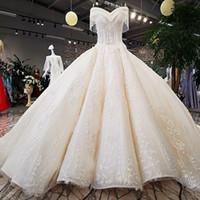 arbeit kleid china großhandel-Handarbeit Brautkleider aus China Fabrik Elfenbein Schulterfrei Schatz Ballkleid Kleid mit langem Zug schnüren sich oben Perlen Brautkleid