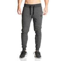 quality sport leggings al por mayor-2018 alta calidad GYMS nuevos hombres pantalones Gymming polainas hombres Fitness entrenamiento Sporting Fitness hombres largos pantalones transpirables