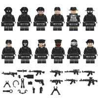 kraft spielzeug großhandel-12 stücke COD SWAT Mini Spielzeug Figur Spezialeinheiten Polizei Figur mit Waffen Mini Baustein Bau Spielzeug Figur für Jungen Kind