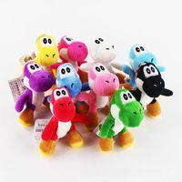 juguete de cosas yoshi al por mayor-Super Mario juguetes de peluche 10 cm / 4 pulgadas dinosaurio Yoshi muñeca de peluche suave Animales de peluche llavero de dibujos animados colgante del teléfono MMA845