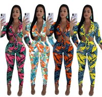 Wholesale Cardigan Two Color Woman - 5set Europe, America, sexy fashion, print chest frenulum sports suit, two piece, 4 color, 6 yards.