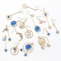 Wholesale blue topaz white gold earrings - Japanese small fresh blue stars moon earrings asymmetrical wild planet geometry round ear hook long sectio designer jewelry leather earrings