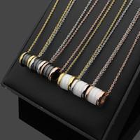 ingrosso catene in oro giallo-Collane in ceramica di lusso nero / bianco con pendenti, oro giallo / oro rosa / metallo color argento Catena in acciaio per donna / uomo in titanio