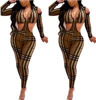 mono corte v al por mayor-Sexy Cut Out Skinny Jumpsuit 2019 Mujeres Imprimir Hollow Out Jumpsuit V-cuello de manga completa Bodycon Party Club Romper rejilla a rayas